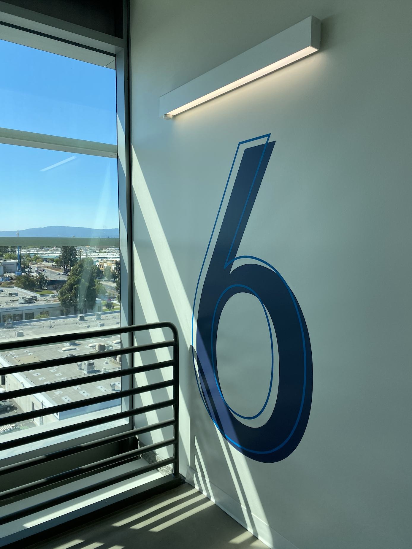 Hand-Painted Stair Numbers at Alexandria Center in San Carlos, California.